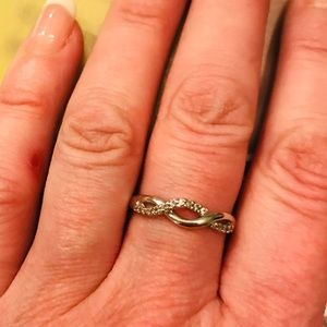 1/10 ct. Diamond Twist Band in Sterling Silver.